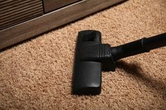 Professional vacuum cleaner. Apartment cleaning service stock image