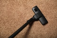 Professional vacuum cleaner. Apartment cleaning service.  royalty free stock photography