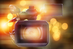 Professional video camcorder in studio. Professional video camcorder in studio with blurred lighting background royalty free stock photography