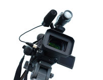 Professional video camera. Professional digital video camera, isolated on white background Royalty Free Stock Images