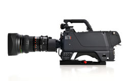 Professional video camera. Facing left isolatad on a white background Royalty Free Stock Images