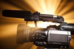 Professional video camera. Against shiny background Stock Photo