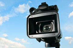 Professional Video Camera. With sky in the background Stock Images