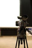 Professional video camera. On a tripod Royalty Free Stock Photos