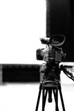 Professional video camera. On a tripod Royalty Free Stock Images