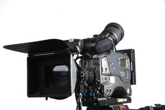 Professional video camera. Side view on white backdrop Royalty Free Stock Photo