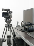 Professional video camera and computer for edition Royalty Free Stock Photo