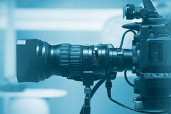 Professional video camera lens. Recording TV show in studio Stock Image