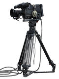 Professional video camera set on a tripod isolated over white Royalty Free Stock Images