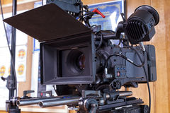 A professional video camera. Camera for shooting feature films and television series royalty free stock photography