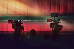 Professional video camera standby for the show on stage. In vintage theater Stock Image
