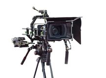 Professional video camera on a tripod. Isolated on white background Stock Images
