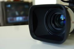 Professional video camera with a TV monitor. On the background Royalty Free Stock Image