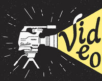 Professional video camera with yellow light Stock Images