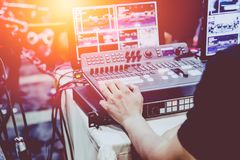 Professional video editor on stage. Professional video editor footage switching on stage duty vintage tone stock image