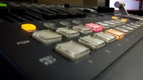 Professional video mixing console with buttons stock image
