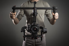 Professional videographer with gimball video slr Stock Photos