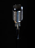 Professional vintage microphone. Isolated on black background royalty free stock image