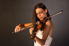 Professional violinist. A young performer who plays the violin Royalty Free Stock Photography