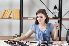 Professional visagiste choosing brush for makeup Royalty Free Stock Photo