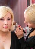 Professional  visagiste does a bright make-up Stock Photos