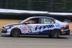 Professional Volkswagon Jetta GLI race car on the track Royalty Free Stock Image