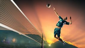 Male professional volleyball player in action at the sunset Stock Photos