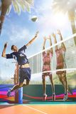 Professional volleyball players in action on the sunny day court