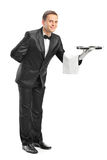 Professional waiter holding a tray Stock Image