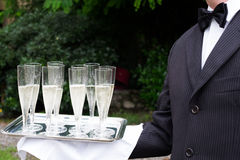 Professional waiter  is serving champagne Royalty Free Stock Photography