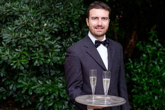 Professional waiter  is serving champagne Royalty Free Stock Photo