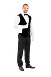 Professional waiter with a towel around his arm Royalty Free Stock Photos