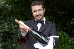 Professional waiter in uniform is serving champagne Royalty Free Stock Photos