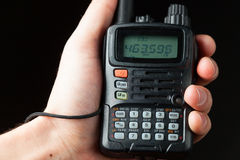 Walkie-talkie radio in hand Stock Photo