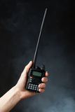 Walkie-talkie radio in hand Stock Photos