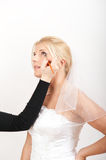 Professional wedding make-up is made to bride Stock Images