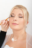 Professional wedding make-up is made to bride Royalty Free Stock Images