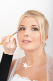 Professional wedding make-up is made to bride Stock Photos