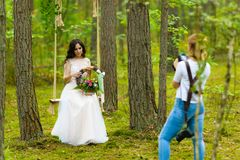 Professional wedding photographer taking close-up portraits of the bride stock image