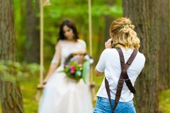 Professional wedding photographer taking close-up portraits of the bride