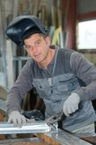 Professional welder during shift in factory Stock Photos
