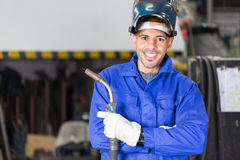 Professional welder posing with wellding machine Royalty Free Stock Images