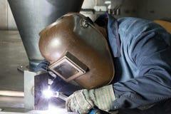 Professional welder welding metal parts Royalty Free Stock Image