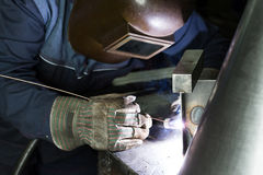 Professional welder welding metal parts. In steel construction company Royalty Free Stock Image