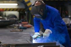 Professional welder welding metal pieces in steel construction Stock Image