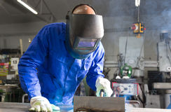 Professional welder welding metal pieces in steel construction Royalty Free Stock Photo