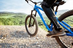 Cyclist riding on the rocky mountains royalty free stock images