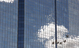 Professional window-cleaners. Cleaning the windows in a large glass corporate office building Royalty Free Stock Image