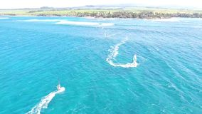 Professional windsurfer surfing in calm blue turquoise ocean water in beautiful summer coast beach seascape in 4k aerial stock video footage