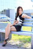 Professional woman drinking coffee in a park Royalty Free Stock Photos